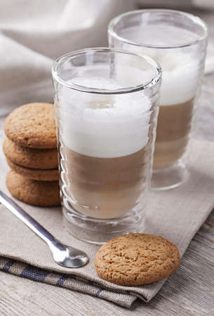 latte macchiato: Glass of Latte macchiato coffee with cookies