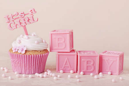 its a girl: Cupcake with a cake pick and baby cubes