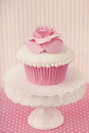 fondant: Cupcake with rose flower on a stand Stock Photo