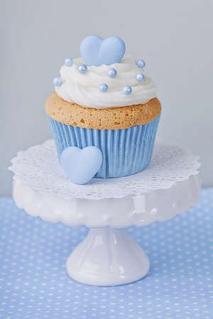 dessert stand: Cupcake with blue heart on a stand