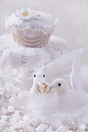 White doves with wedding rings photo