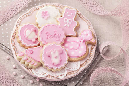 baby shower party: Baby cookies on a pink plate Stock Photo