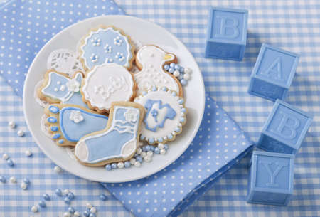 icing sugar: Baby cookies on a white plate