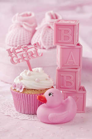 Cupcake with a cake pick and baby decoration photo