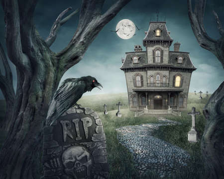 Haunted house and spooky graveyard photo