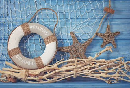 marine life: Life buoy decoration on blue shabby background Stock Photo