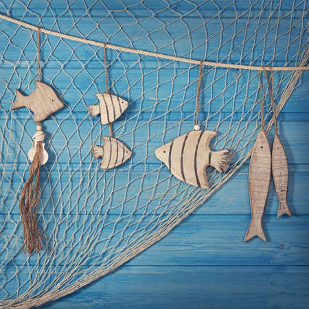 fishing net: Marine life decoration and on blue shabby background