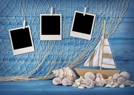 Marine life decoration and instant photos on blue shabby background photo