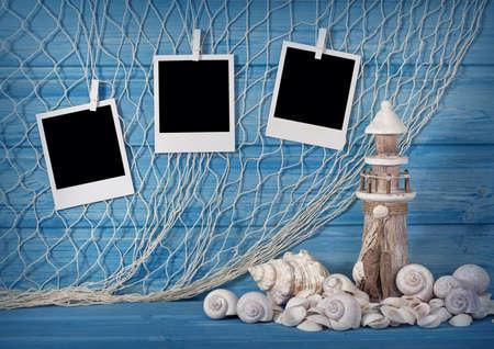 Marine life decoration and instant photos on blue shabby background Stock Photo - 20410820