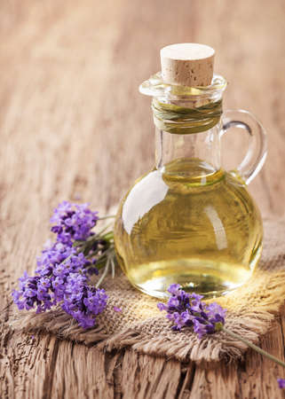 aromatherapy oils: Lavender spa treatment on wooden background