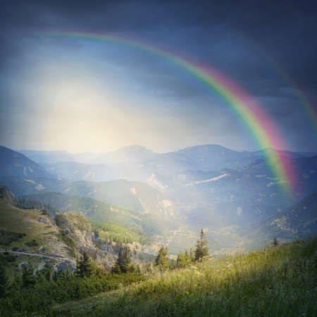 rainy day: Landscape with rainbow and clouds