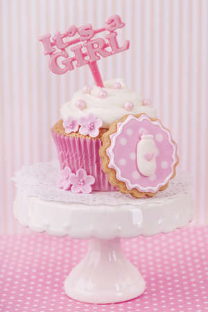 Cupcake with a cake pick on a stand photo