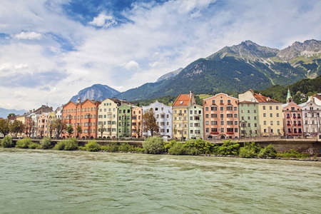 Colorful houses on a riverside, Innsbruck, Austria photo