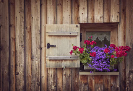 Old wooden window with shutters photo