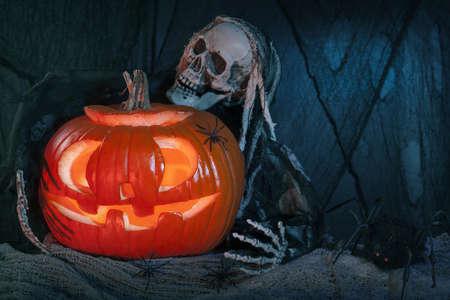 Skull monster and halloween pumpkin decoration photo