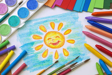 childs: Childs drawing with colorful crayons
