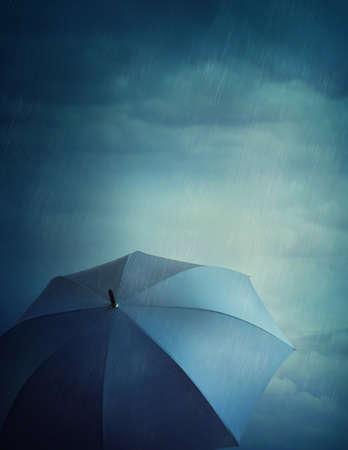 umbrella rain: Dark stormy clouds and umbrella