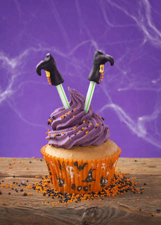 Halloween cupcake with witch legs photo