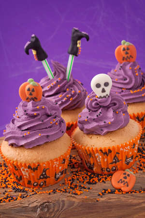 Halloween cupcake on purple background