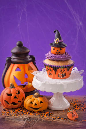 Halloween cupcake and  pumpkin decoration photo