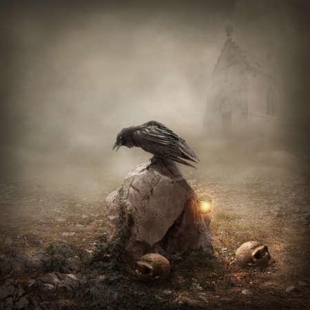 Crow sitting on a gravestone photo