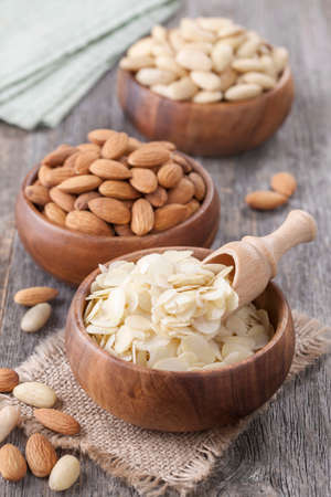 Bowls with almonds nuts on wooden table Stock Photo - 22927594