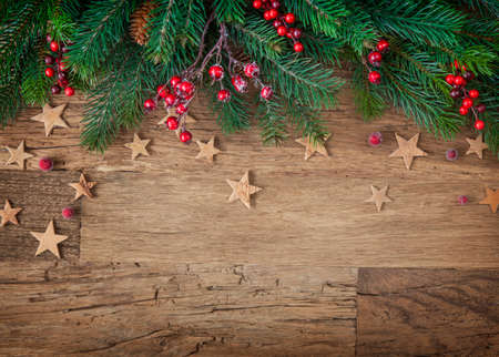 copy: Christmas fir tree on wooden background