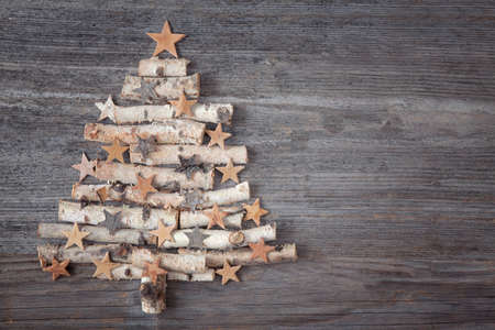 Christmas tree on wooden background Reklamní fotografie - 23195056