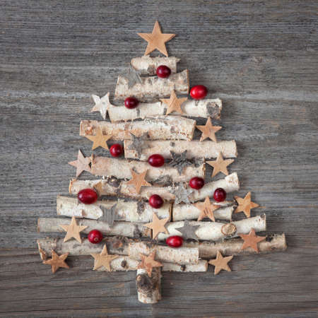 vintage: Christmas tree on wooden background