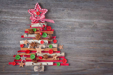 christmas vintage: Christmas tree on wooden background