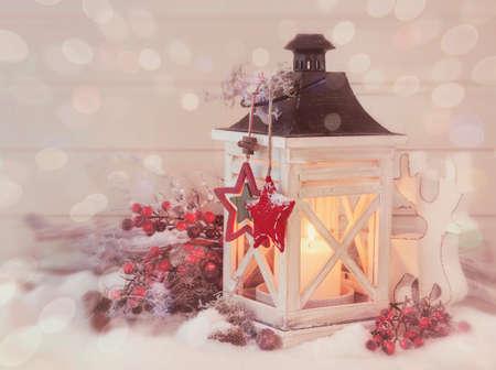 Burning lantern and christmas decoration on white background photo