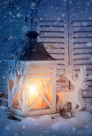 Burning lantern and christmas decoration in the evening photo
