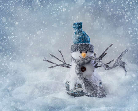 christmas fun: Smiling snowman standing in the snow