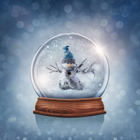 glass globe: Snow globe with snowman on a blue background