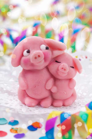 anniversary wishes: Marzipan pigs on white background Stock Photo