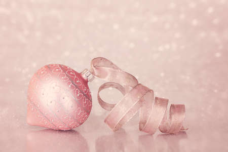 Pink christmas ornament on  blurred background