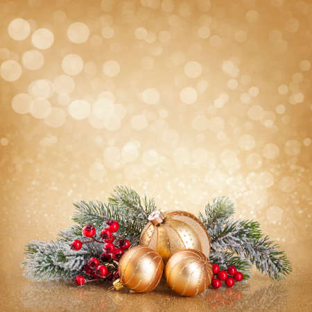Christmas golden decoration with balls and fir tree