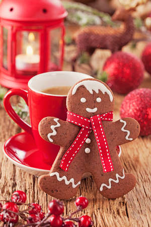 Christmas gingerbread man and hot drink photo