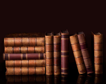 Old vintage books standing in a row Stock Photo - 23917087