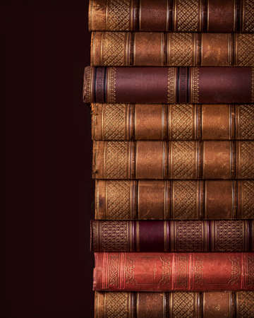 ancient books: Pile of ancient books on brown background