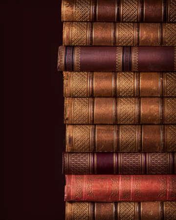 Pile of ancient books on brown background Reklamní fotografie - 23917094