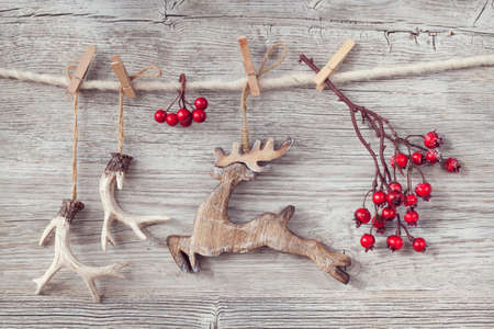 christmas reindeer: Christmas decoration over wooden background