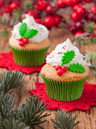 Christmas cup cakes with holly berry photo