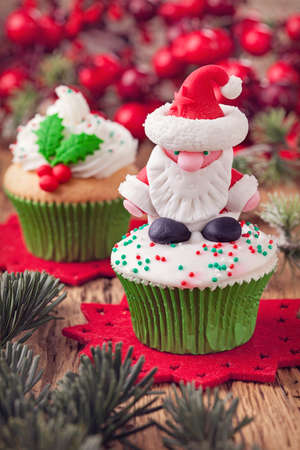 Christmas cup cakes with santa and holly berry photo