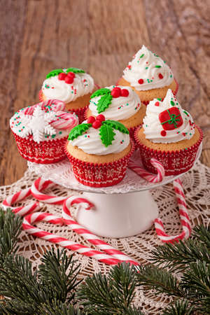 Christmas cup cakes and candy canes photo