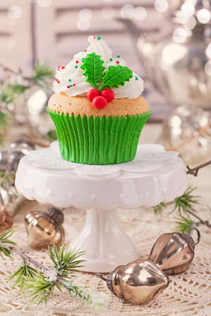 Christmas cup cake with holly berry photo