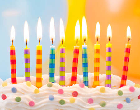 happy birthday: Birthday candles on colorful background Stock Photo