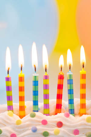 Birthday candles on colorful background photo