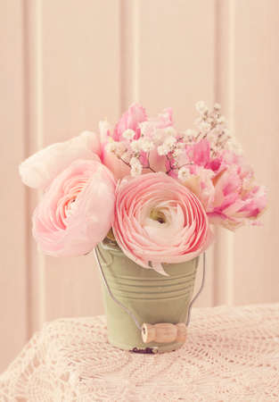 Pink ranunculus flowers on a white wooden background photo