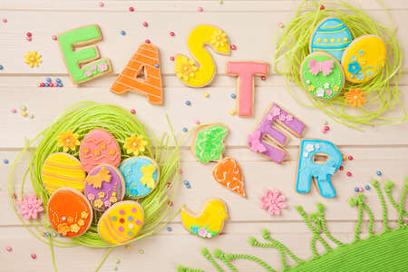 Colorful easter cookies on a wooden background Stock Photo